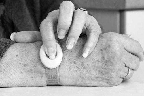 a medical alert button on wrist